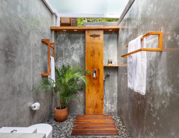 Rain shower in the modern bathroom of vacation rental Villa Uma Dewi Sri in Sidemen in Bali