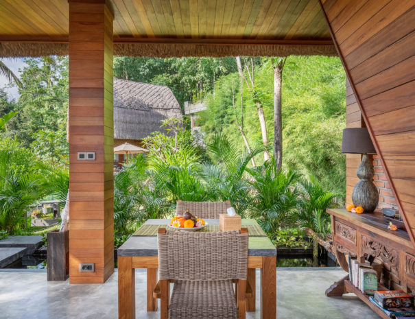 View from the dining area into the lush garden of vacation rental Villa Uma Dewi Sri in Sidemen in Bali